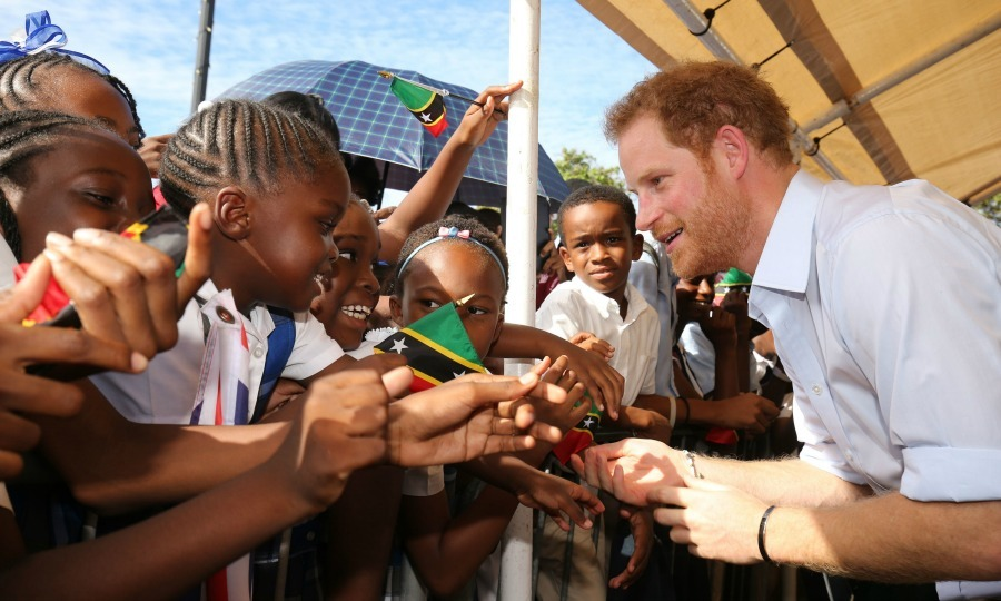 Harry got a warm welcome to Nevis from some friendly faces. 