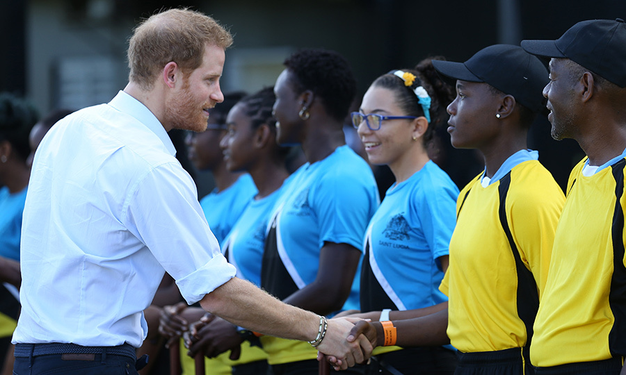 Prince Harry was greeted by local teams as he arrived to watch an exhibition cricket match at the Darren Sammy Cricket Ground in Castries, Saint Lucia.