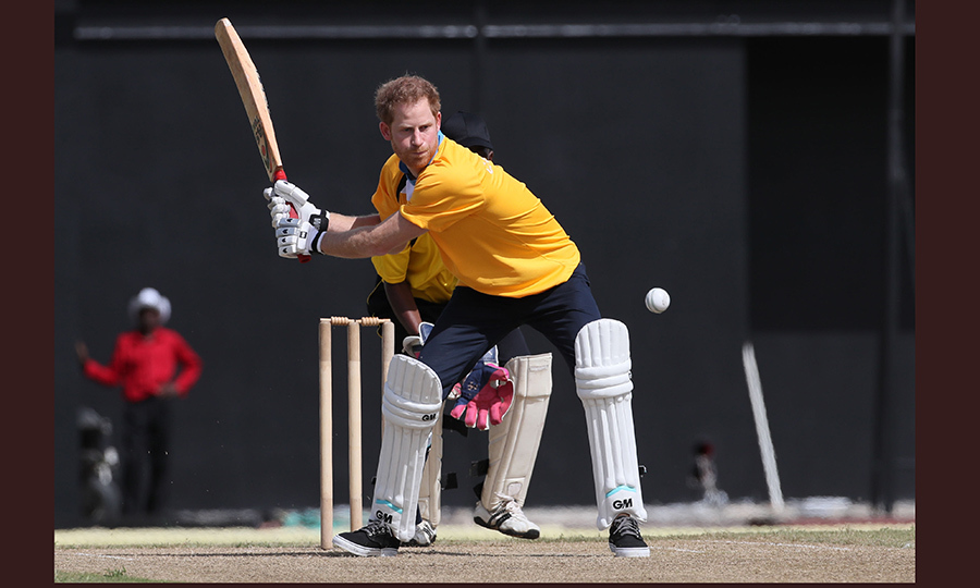 The concentration! Prince Harry got caught up in the action during an exhibition cricket match at the Darren Sammy Cricket Ground.