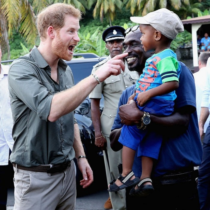 Wonder if Prince Harry was telling this two-year-old about his niece and nephew during his visit.