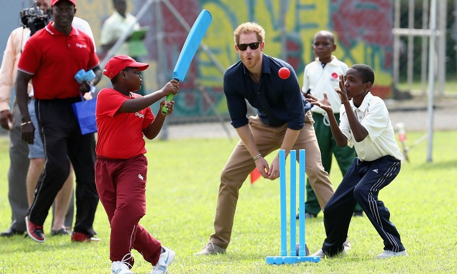 Start the day in motion! Harry couldn't resist jumping on the field and playing a game of cricket with students from the Junior Murray Cricket Academy during the sporting event.  