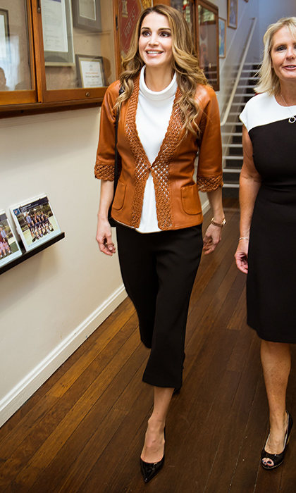 Jordan's Queen Rania rocked a leather blazer and trendy culottes for her visit to the Fort Street School in Sydney, Australia on November 24.
