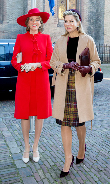 Each with gloves, shoes and clutch bags in a respective matching hue, Queen Mathilde of Belgium and Queen Maxima of the Netherlands gave us a lesson in accessorizing as they arrived for a government lunch in The Hague on November 29.