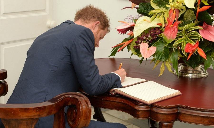 Prince Harry left his mark in the official guest book inside of the Government House. 