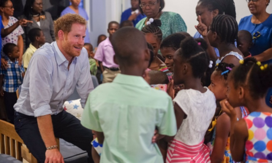 A little rain didn't stop Harry from making a stop at the Nightingale Children's Home. 