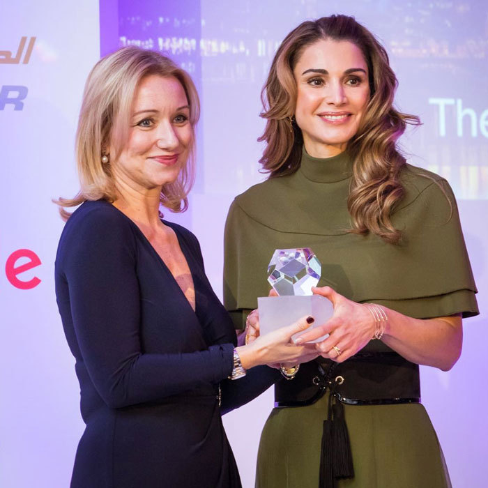 Queen Rania beamed as she received the Foreign Press Association's Humanitarian Award. 