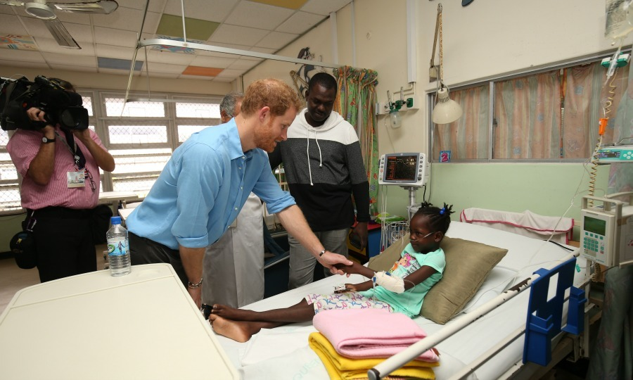 Harry shook the hand of a sick young patient and made her smile during his visit to the Queen Elizabeth Hospital. The Prince, who last visited the hospital in 2010, visited the children's ward and spent time cheering up the sick children. 