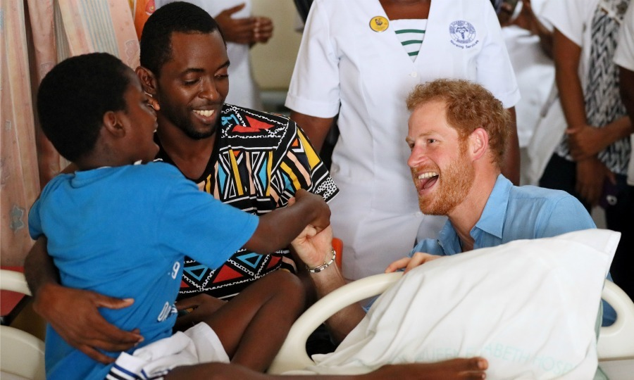 Harry shared a laugh with a young boy at the Queen Elizabeth hospital during his visit. 