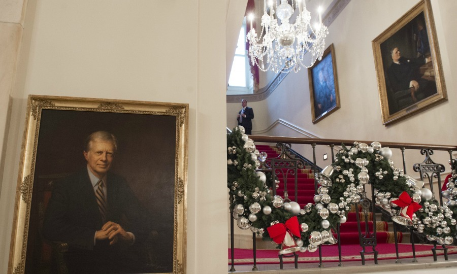 More than 90 volunteer decorators from 33 states arrived on Thanksgiving to begin the decorating process at the White House. Tasks ranged from hauling boxes to hanging lights, in addition to wreaths and trimming foyers and banisters around the mansion. 