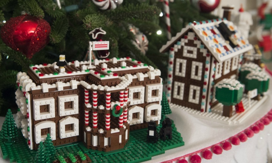 Fifty-six Lego gingerbread houses that represent each state and U.S. territory are featured in the branches of trees in the State Dining Room. 