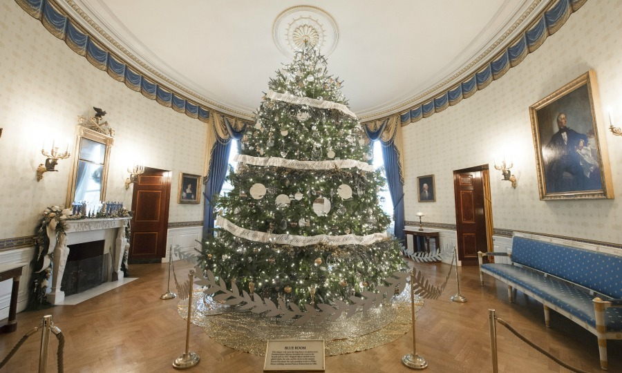 The tree of all trees! The 19-foot Douglas fir stands tall in the Blue Room decked with gold and silver ornaments and decorated with a metallic garland that reads the preamble to the Constitution. The tree, which arrived the day after Thanksgiving, took four days to decorate, according to a volunteer decorator. 