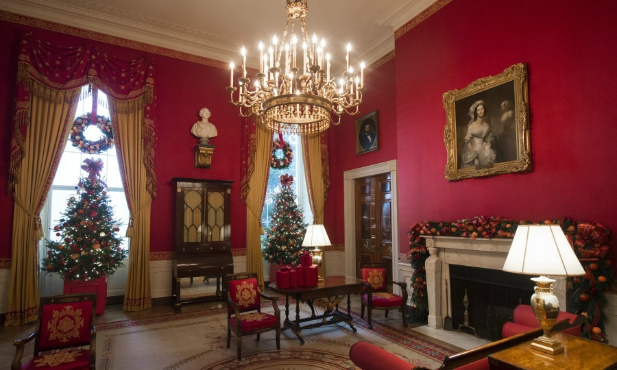 Each room got a touch of holiday magic. The Red Room is decorated with various small trees and color-coordinating trim. 
