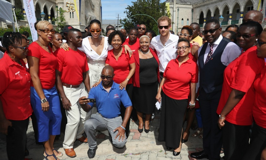 Prince Harry and Rihanna, threw on their shades, and  posed with workers at the Barbados National HIV/AIDS Commission after taking live HIV test on World Aids Day. 