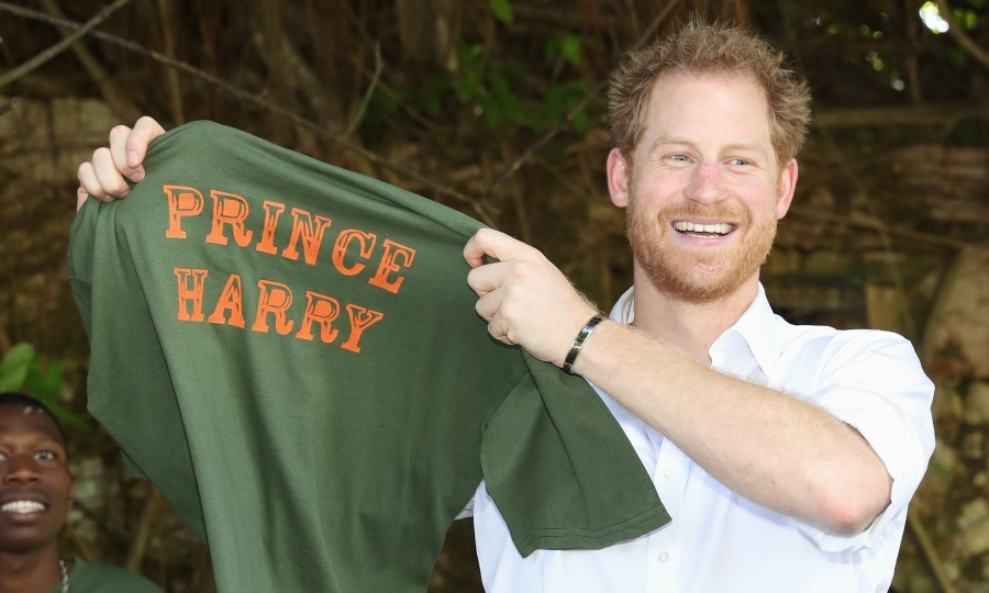 Prince Harry proudly showed off his personalized shirt during his visit to the Nature Fun Ranch. 