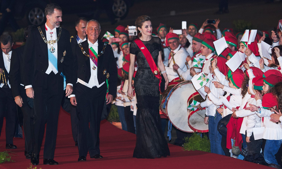 Queen Letizia of Spain looked regal on the first day of her official visit to Portugal. The Spanish monarch, join by her husband King Felipe and President of Portugal Marcelo Rebelo de Sousa, stunned in a black gown for a gala dinner held at the Palace of the Dukes of Braganza.