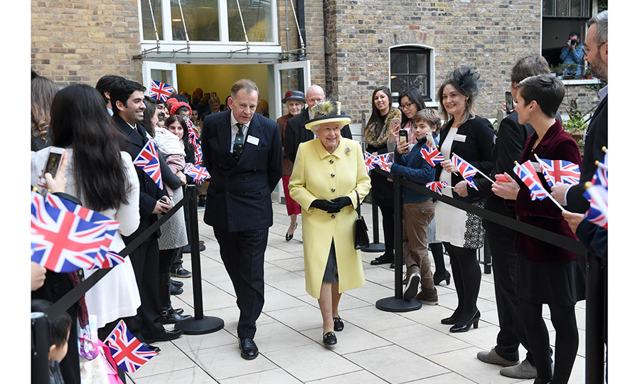 Queen Elizabeth II got a flag-waving welcome when she met members of Goodenough College, a leading residential community for British and international postgraduate students in London.
