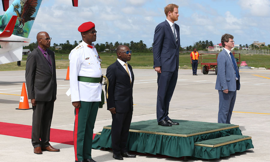 The British royal looked sharp in a navy suit and tie after disembarking his aircraft at Guyana.