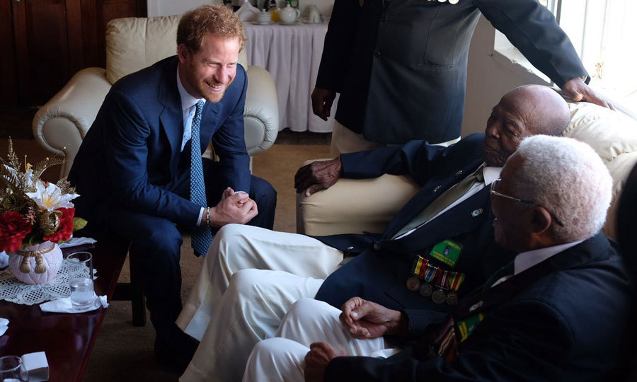 The cheeky royal shared a laugh with veterans in Guyana.