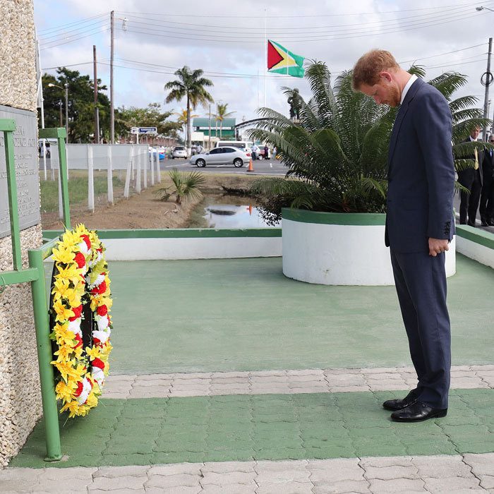 The royal bowed his head after laying a wreath at the Guyana Independence Arch in Georgetown.