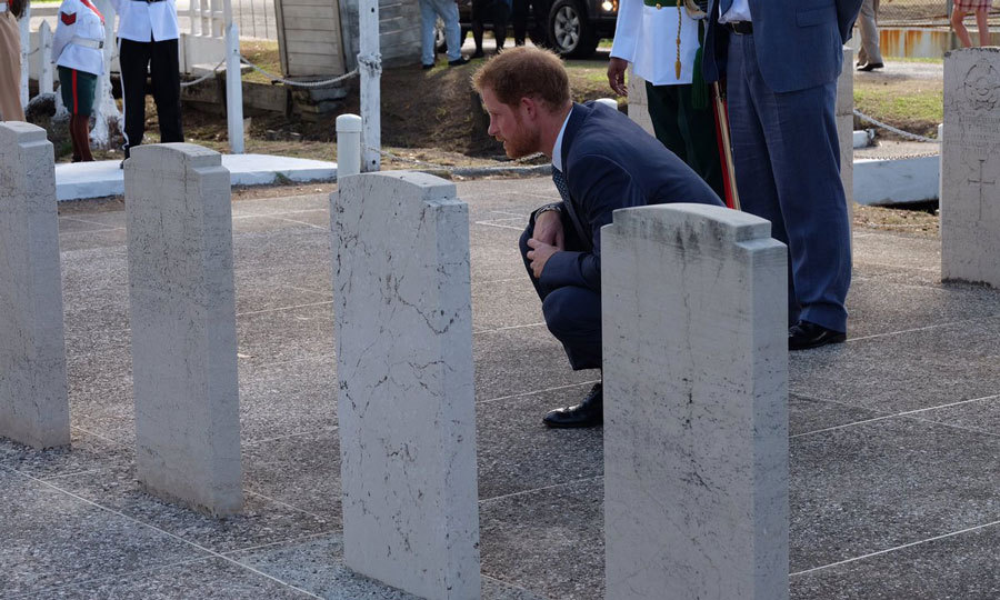 After laying a wreath at the Georgetown's Commonwealth War Graves, in honor of those who lost their lives in WWI, WWII and pre-independence, the royal knelt down to read names off war graves.