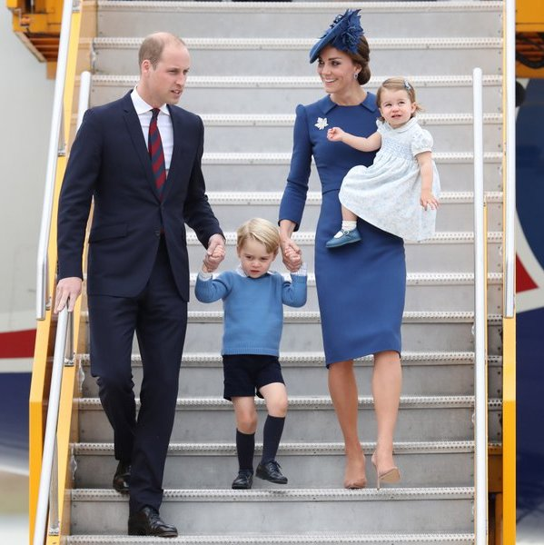 September 2016: Prince William, the Duchess of Cambridge and their children matched in blue as they arrived in Victoria, BC for their eight-day tour of the country as a family.
