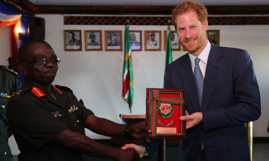 Prince Harry accepted a gift during his visit to Camp Ayanganna, the headquarters of the Guyana Defence Force, in Georgetown, Guyana.