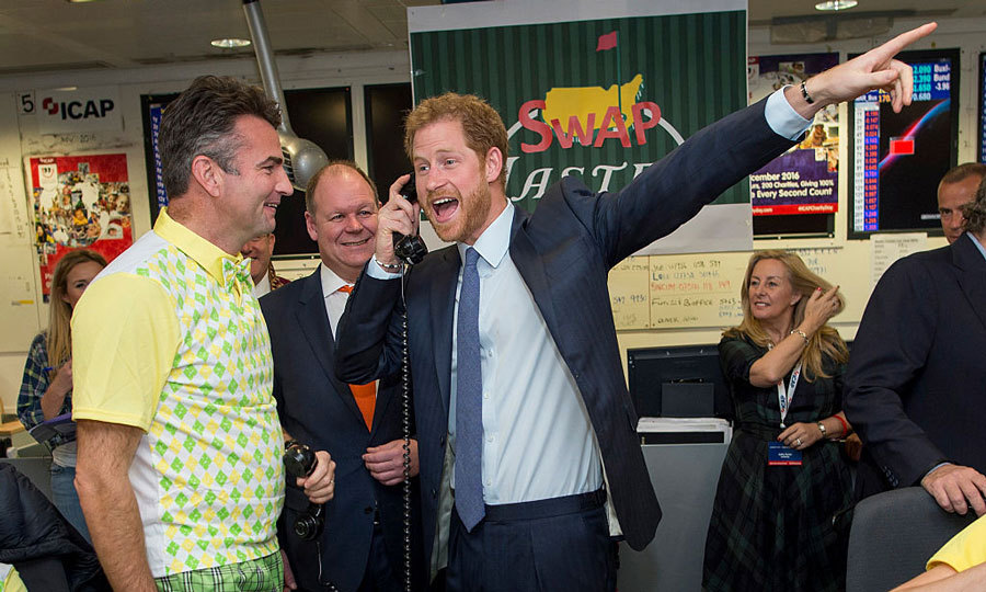 "After his 15-day royal tour of the Caribbean and visiting girlfriend Meghan Markle in Toronto, Prince Harry returned to London to take part in ICAP Charity Trading Day on behalf of his charity Sentebale. The royal joked on the trading floor, ""I'm not entirely sure what country we're in.""