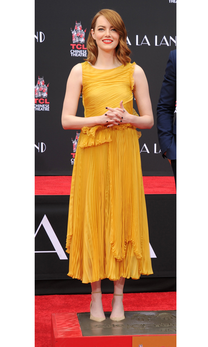<i>La La Land</i> actress Emma Stone kept on trend wearing a Rochas dress paired with Jimmy Choo shoes at her hand and footprint ceremony held at the TCL Chinese Theatre IMAX in Hollywood, California.