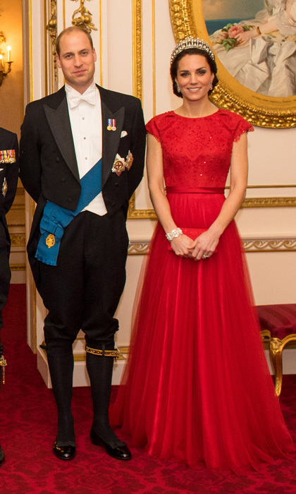 The Duchess of Cambridge looked regal in a bespoke, lace gown by Jenny Packham, which she topped off with the Cambridge Lover's Knot Tiara. The stylish royal recycled the scarlet number for the 2016 Diplomatic Reception held at Buckingham Palace. Kate first wore the dress in 2015 to her first state banquet dinner with Chinese President Xi Jinping and his glamorous wife Peng Liyuan in 2015.