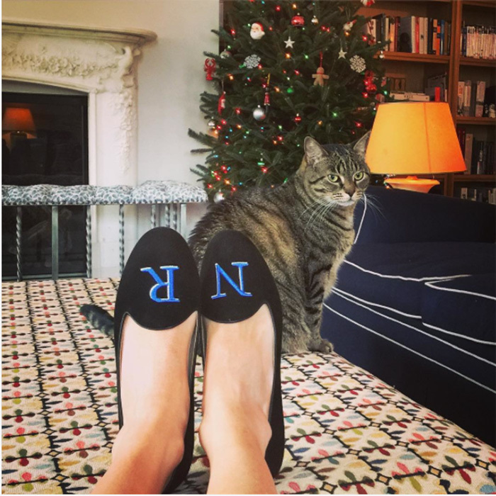 Nicky Hilton Rothschild showed off her initials on her cozy loafers as she chilled next to her Christmas tree (and her cat!).