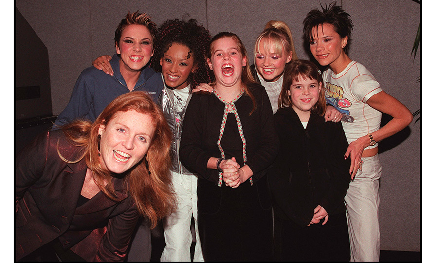 Girl power! The Duchess of York scored cool mom points in 1999 taking Princesses Beatrice and Eugenie backstage to meet the Spice Girls (Melanie Chisholm, Melanie Brown, Emma Bunton and Victoria Beckham).