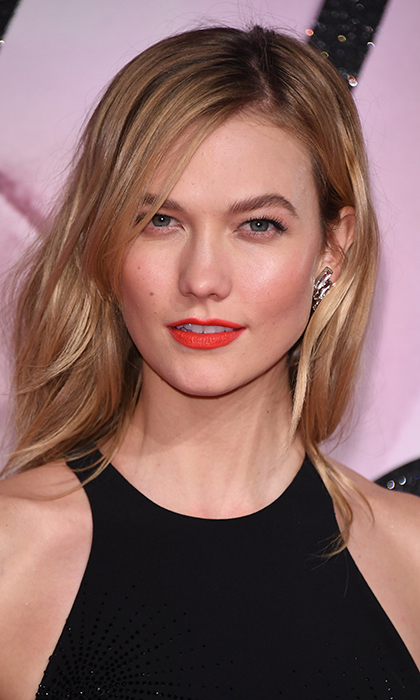 Karlie Kloss let her bold red lips do the talking at the British Fashion Awards on December 5 in London. 