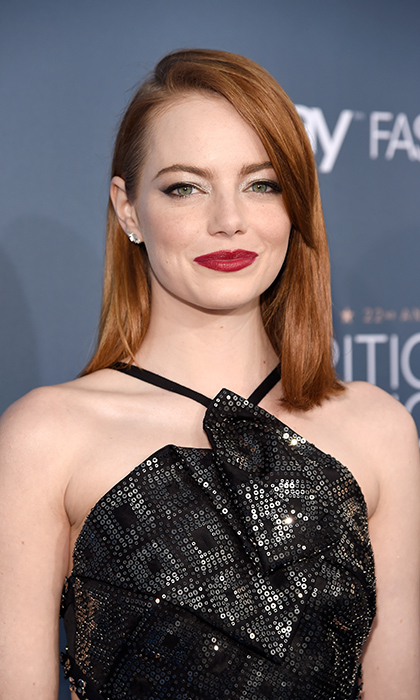 Actress Emma Stone sported a classic red lip - winged eyeliner combo at the 22nd Annual Critics' Choice Awards on December 11 in Santa Monica. 