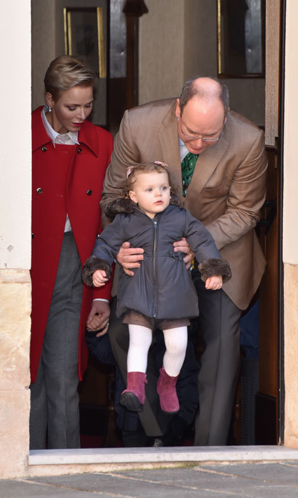 Gabriella, looking adorable in white tights and purple booties, got a lift from her father as she made her way to the Christmas festivities.
