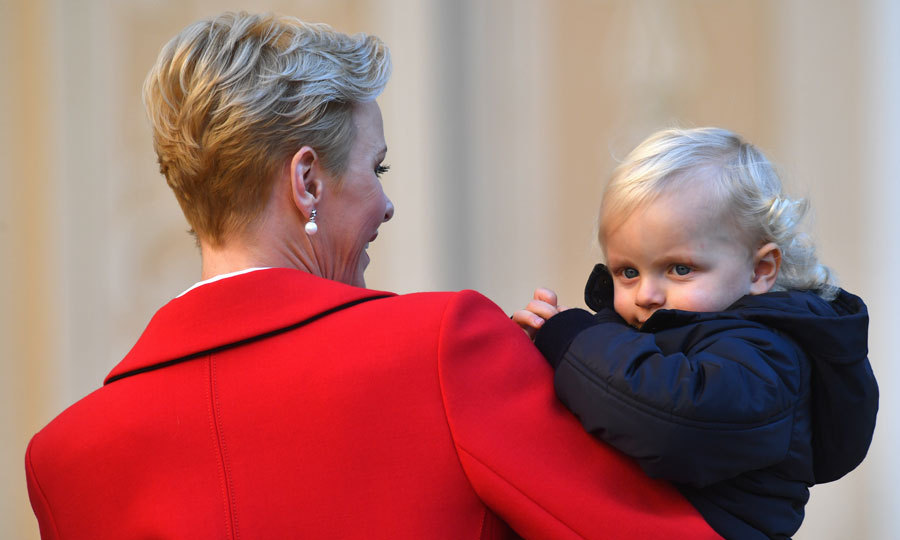Jacques looked snug as an adorable bug in the arms of his chic mother.