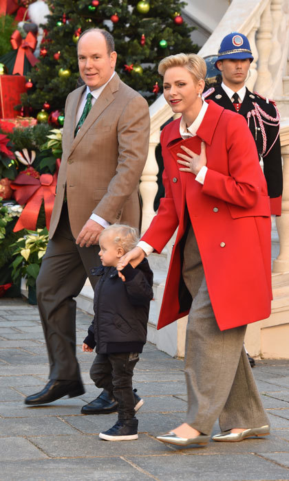 Princess Charlene looked festive for the occasion donning a vibrant red coat, which she paired with grey trousers and pointed silver Jimmy Choo flats.