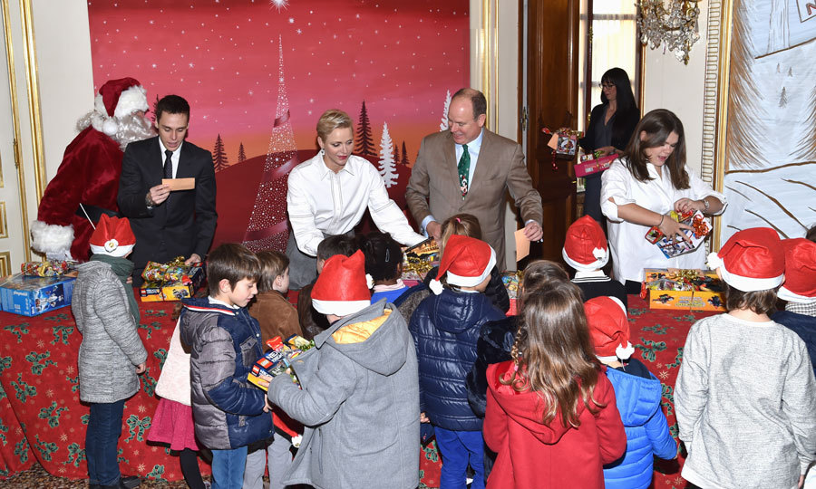 Prince Albert handed out toys at the palace's traditional Christmas gifts distribution alongside his wife, nephew Louis Ducruet and niece Camille Gottlieb.