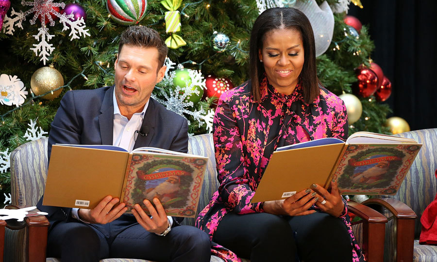 Ryan Seacrest and First Lady Michelle Obama read holiday stories to children during a visit to The Children's National Health System in Washington, D.C. 