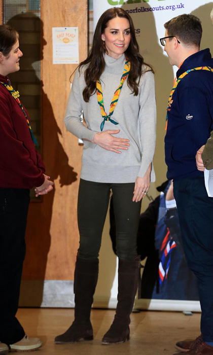 Kate Middleton traded her tiara and gowns for a more casual, albeit chic look for her December meeting with cub scouts. The royal, who has previously worked as a volunteer with a cub scout pack, wore a grey cashmere turtleneck sweater by Iris and Ink, which she paired with dark trousers and her trusty Really Wild Clothing Spanish Boots for the outing. The royal accessorized the outdoorsy outfit with a Cubs 100 scarf around her neck.