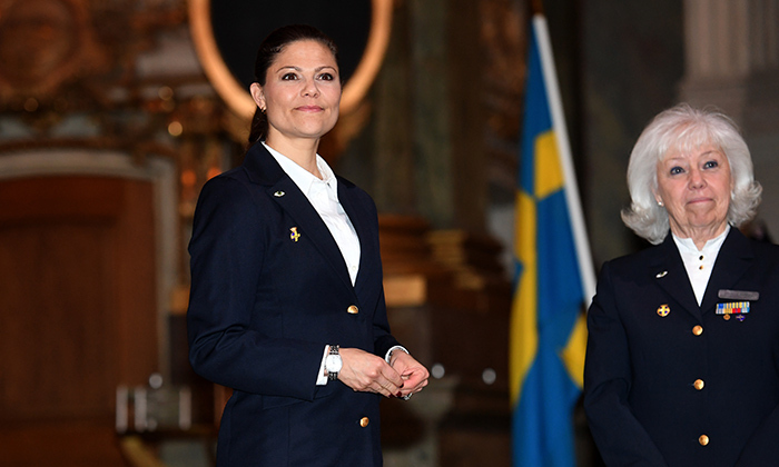 Crown Princess Victoria was in flight mode with Corps Manager Christina Hamberg during the Stockholm Women's Voluntary Air Defence Organization's Christmas gathering at the Royal Chapel at the Palace in Stockholm on December 12.