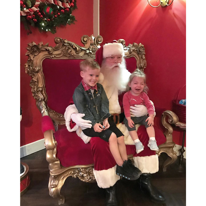 "Say Santa! Hillary Duff's son Luca joined little cousin Ryan Rosenberg for a ""classic"" holiday moment. Haylie Duff shared a photo of her crying daughter and cheery nephew writing, ""Thank you @thegrovela for giving our family this classic moment! Haha  #Santa #Tears #cousins #Christmas.""