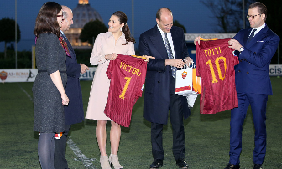 Princess Victoria and her husband Prince Daniel were gifted AS Roma soccer jerseys from AS Roma's general manager Mauro Baldissoni during their visit to the soccer club at the St. Peter's Pontifical Oratory.