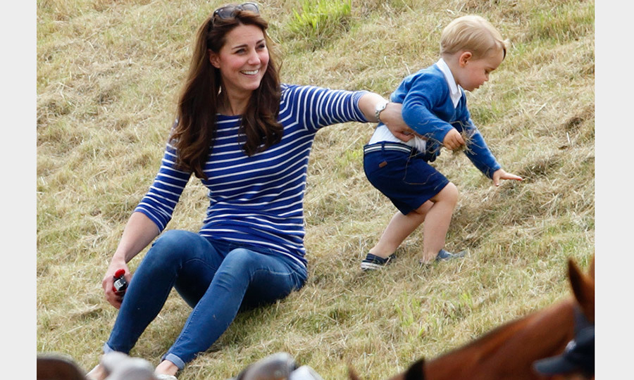 Catherine, Duchess of Cambridge wore a laid back ME-EM top as she played with Prince George of Cambridge at the Gigaset Charity Polo Match at England's Beaufort Polo Club in 2015. 