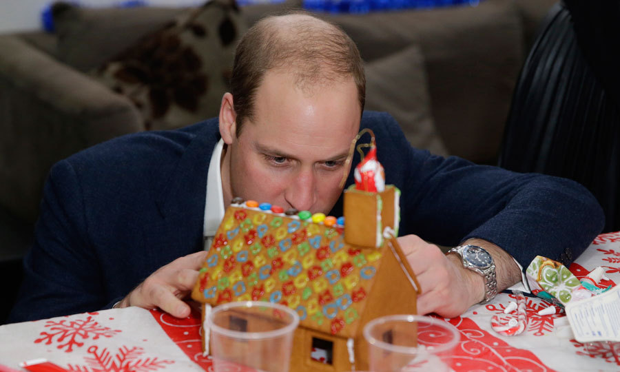 The Duke was in the zone as he decorated a gingerbread house at the holiday party.