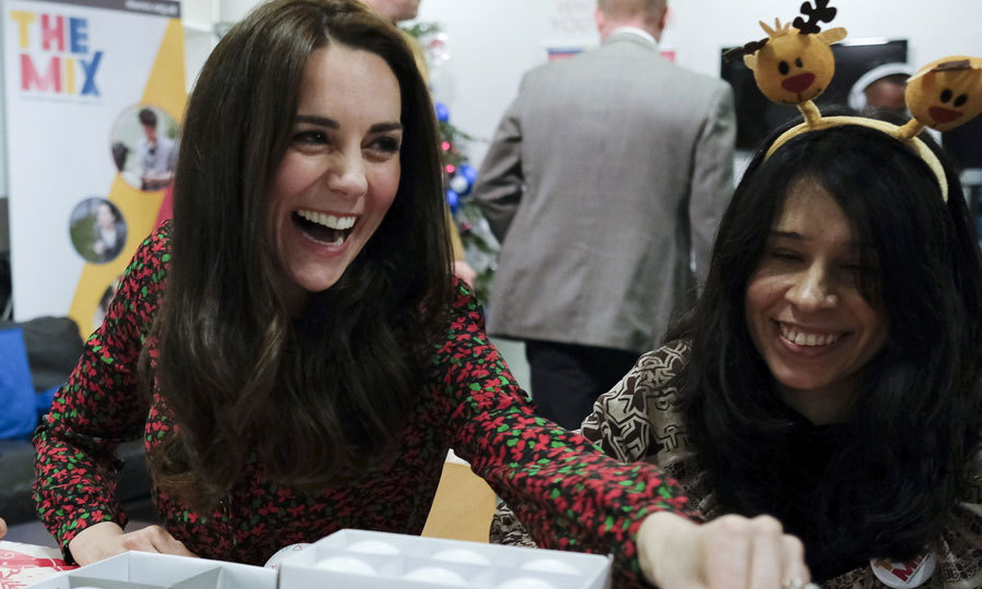 Prince George's mom shared a laugh with a young woman as she took part in holiday activities at the party.