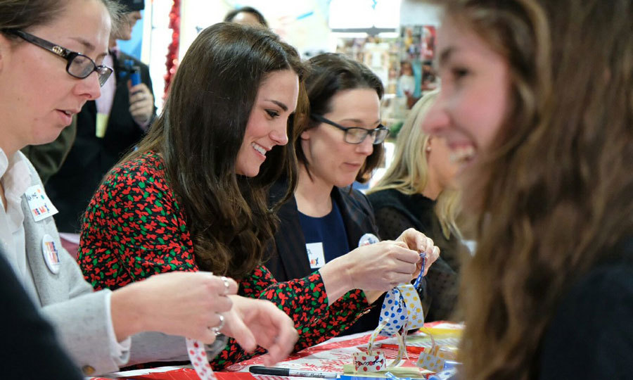 Princess Charlotte's mom showed off her crafty side creating holiday decorations out of paper. The royals and volunteers added words of support to the paper chains. 