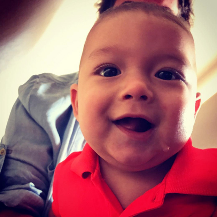 Nicole Johnson's baby boy flashed a happy grin before embarking on a trip.