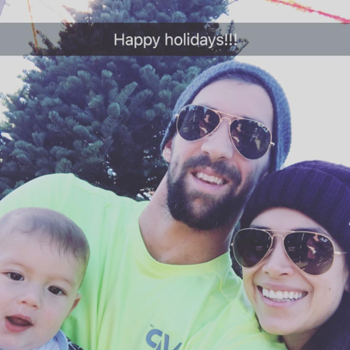 "Boomer's first tree! Michael Phelps shared a picture with his wife and son Christmas tree shopping. Attached to the picture, the Olympian wrote, ""Happy holidays to all!!! @boomerrphelps got his first Christmas tree today!! #babysfirstchristmas #family.""