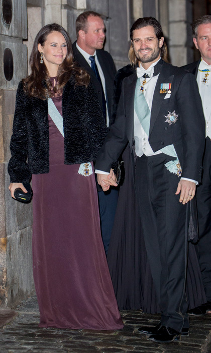 Princess Sofia wowed at the Swedish Academy's annual meeting held at the Old Stock Exchange building in Stockholm. Prince Carl Philip's wife channeled Kate Middleton stepping out with a fresh blowout for the event, which she paired with a full-length deep purple gown.