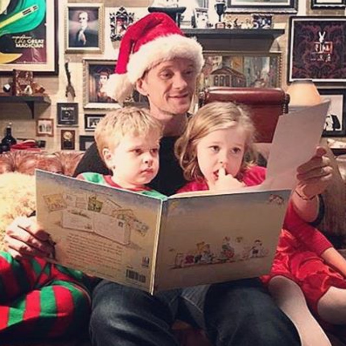 "Neil Patrick Harris enjoyed one of his family's holiday traditions by reading son Gideon and daughter Harper a story. The actor noted of his family, ""We love books!""